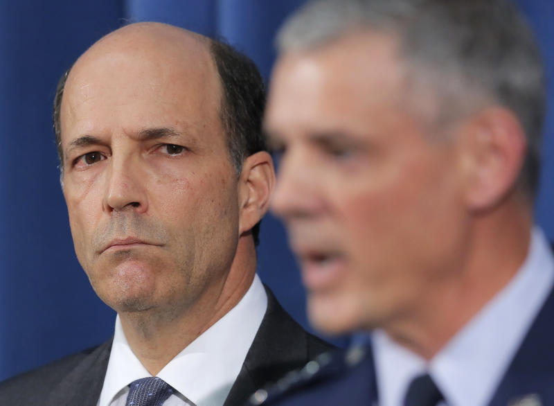 Commander of U.S. Forces in Japan Lt. Gen. Salvatore Angelella, right, speaks to the media as U.S. Ambassador to Japan John Roos looks on at the U.S. Embassy in Tokyo, Friday, Oct. 19, 2012. Angelella said American military personnel will be subject to a curfew and other restrictions following allegations two U.S. sailors raped a woman in Okinawa. (AP Photo/Itsuo Inouye)