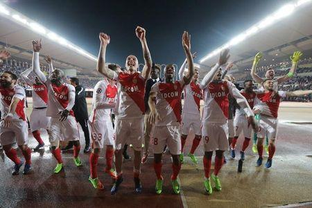 Monaco's players celebrate after the game