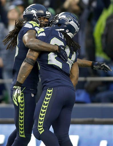 Seattle Seahawks running back Marshawn Lynch (24) is congratulated by wide receiver Sidney Rice after scoring on a 33-yard touchdown run against the Arizona Cardinals during the third quarter of an NFL football game in Seattle, Sunday, Dec. 9, 2012. (AP Photo/John Froschauer)