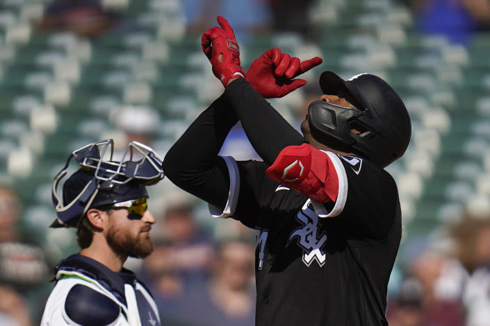 Chicago White Sox's Eloy Jimenez, right, celebrates his two-run home run as Detroit Tigers catcher Eric Haase looks on in the seventh inning of a baseball game in Detroit, Monday, Sept. 27, 2021. (AP Photo/Paul Sancya)