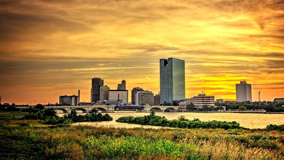 downtown Toledo Ohio's skyline at sunset from across the Maumee river.