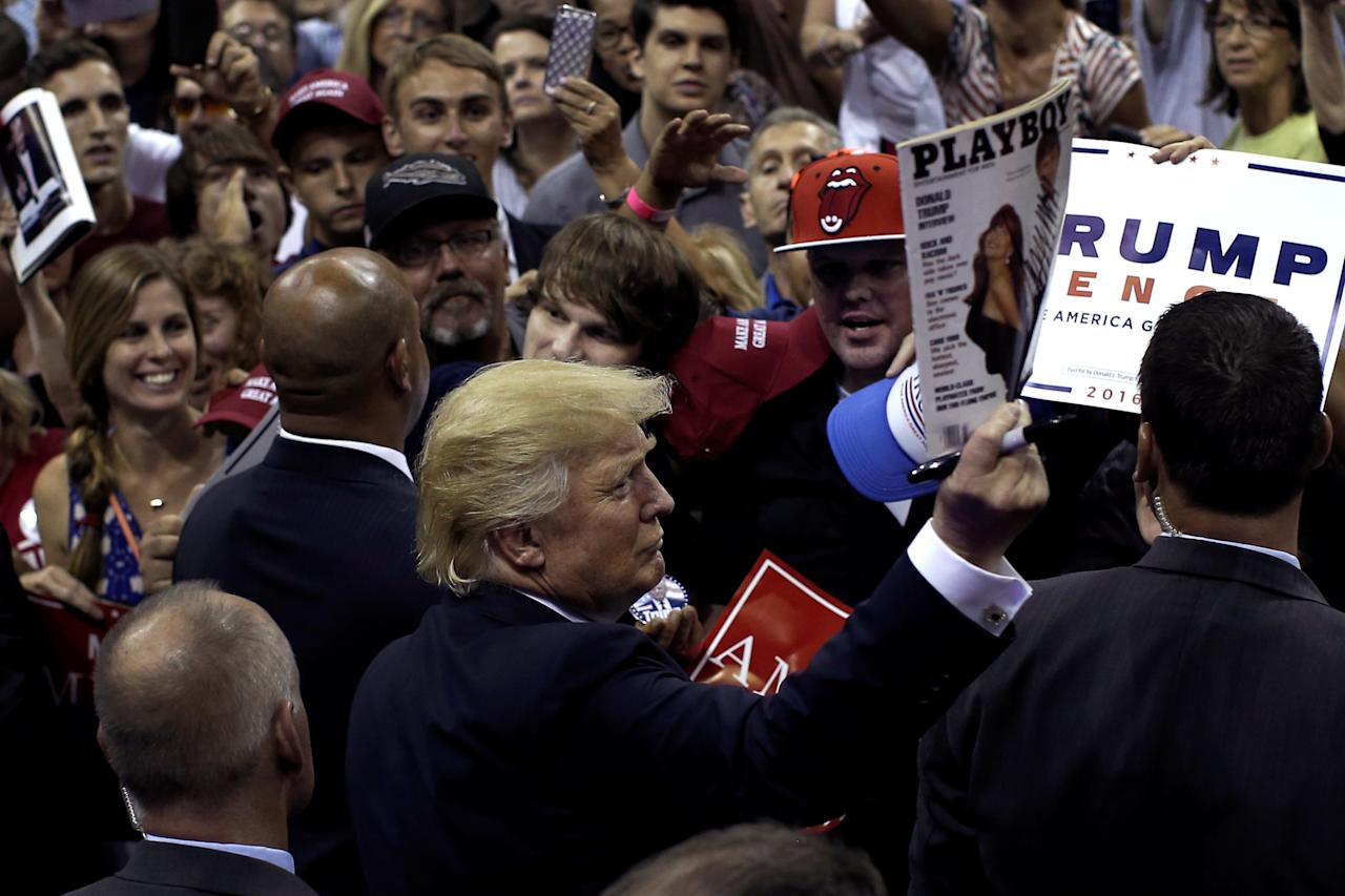 <p>Republican presidential nominee Donald Trump holds up a <em>Playboy</em> magazine handed to him by a supporter after speaking at a campaign rally in Pensacola, Fla., Sept. 9, 2016. (Photo: Mike Segar/Reuters) </p>