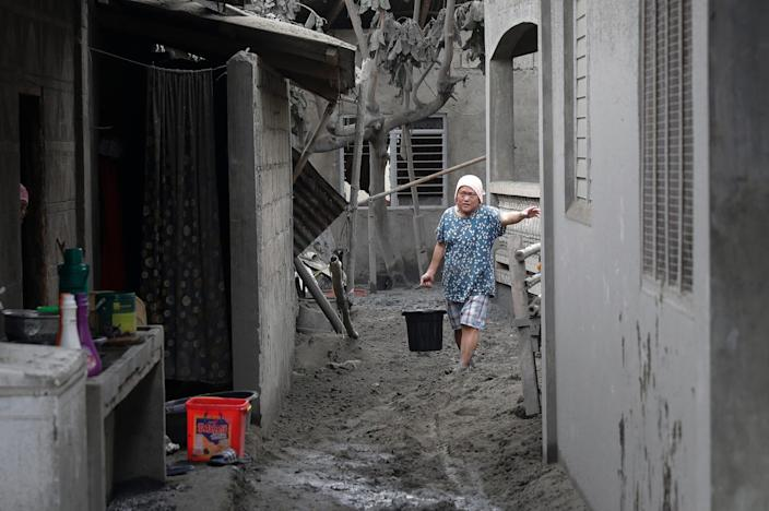 A resident of water at the volcanic ash town covered in Laurel, Batangas province.
