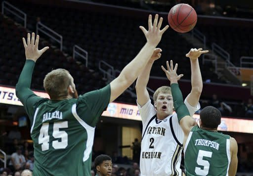 Western Michigan's Connar Tava (2) passes the ball in front of Eastern Michigan's Matt Balkema (45) and Derek Thompson (5) in the first half during an NCAA college basketball game at the Mid-American Conference men's tournament on Thursday, March 14, 2013, in Cleveland. Western Michigan won 70-55. (AP Photo/Tony Dejak)