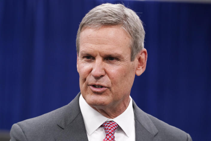 File-This Nov. 10, 2020, file photo shows Tennessee Gov. Bill Lee speaks with reporters in Nashville, Tenn. Lee has tweeted that his wife has mild symptoms of COVID-19 after testing positive for the coronavirus. The Republican governor said Saturday, Dec. 19, 2020, that he has tested negative for the virus but will be quarantined at the Governor's Residence out of an abundance of caution. (AP Photo/Mark Humphrey, File)