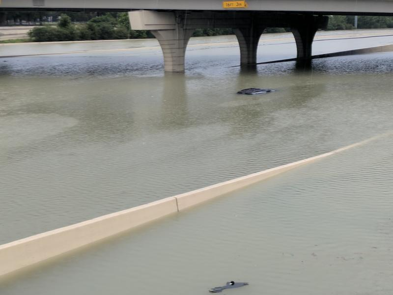 A submerged car in Katy, Texas, during the storm. Authorities are urging people to stay off the roads. (David Lohr/HuffPost)