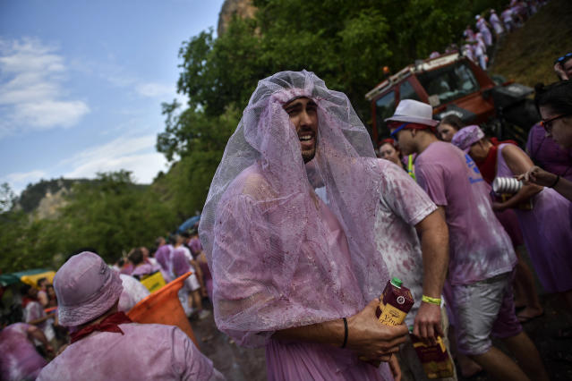 <p>People take part in a wine battle, in the small village of Haro, northern Spain, Friday, June 29, 2018. (Photo: Alvaro Barrientos/AP) </p>