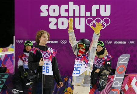 Switzerland's winner Iouri Podladtchikov (L) watches as Shaun White of the U.S. (R) gestures after the men's snowboard halfpipe final event at the 2014 Sochi Winter Olympic Games, in Rosa Khutor February 11, 2014. REUTERS/Mike Blake
