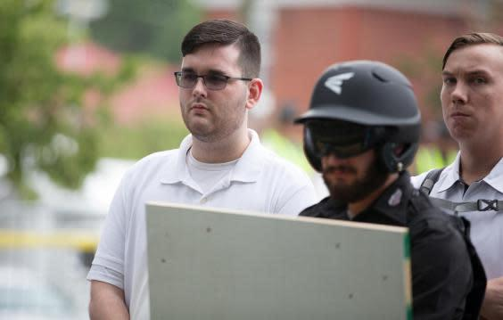 James Alex Fields Jr, (L) seen attending the Unite the Right rally in Charlottesville prior to arrest (REUTERS)