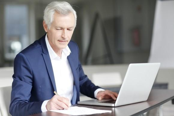 Older man working at a laptop