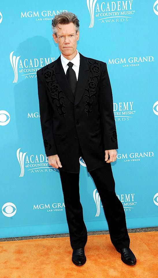"""Randy Travis  Grade: C   In the '80s, the """"I Told You So"""" singer was the toast of the ACM Awards, but at this year's ceremony, he was nearly mistaken for Carrie Underwood's chauffeur in a painfully-understated getup. Rick Diamond/<a href=""""http://www.gettyimages.com/"""" target=""""new"""">GettyImages.com</a> - April 18, 2010"""