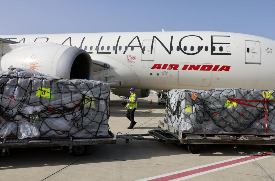 Workers load medical aid to be flown in an Air India aeroplane to India, at Israel's Ben Gurion Airport near Tel Aviv, on May 4, 2021. - India's total COVID-19 caseload neared 20 million as oxygen shortages in hospitals exacerbated a devastating second wave, and much-needed foreign assistance continued to pour in. (Photo by Menahem KAHANA / POOL / AFP) (Photo by MENAHEM KAHANA/POOL/AFP via Getty Images)