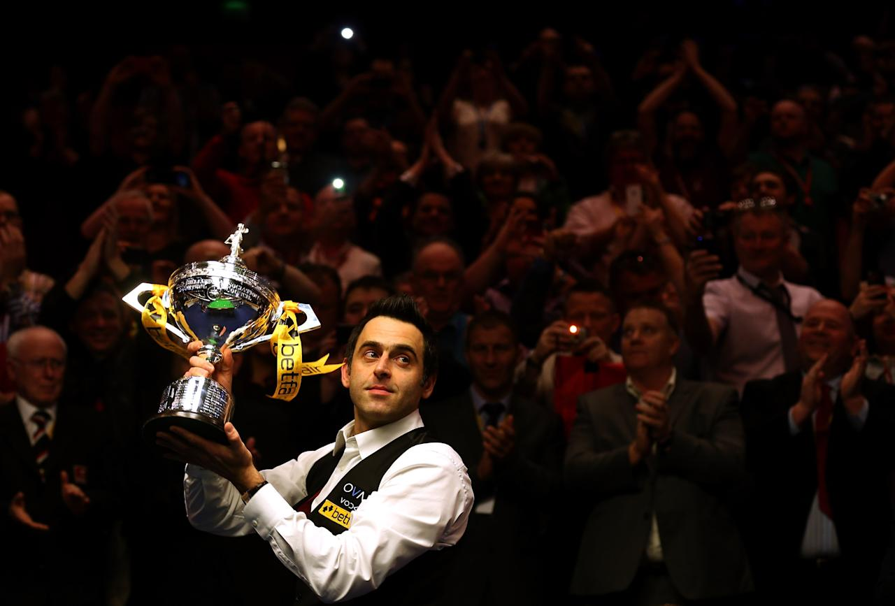 SHEFFIELD, ENGLAND - MAY 06:  Ronnie O'Sullivan of England poses with the trophy and his son Ronnie after beating Barry Hawkins of England to win the Betfair World Snooker Championship at the Crucible Theatre on May 6, 2013 in Sheffield, England.  (Photo by Warren Little/Getty Images)