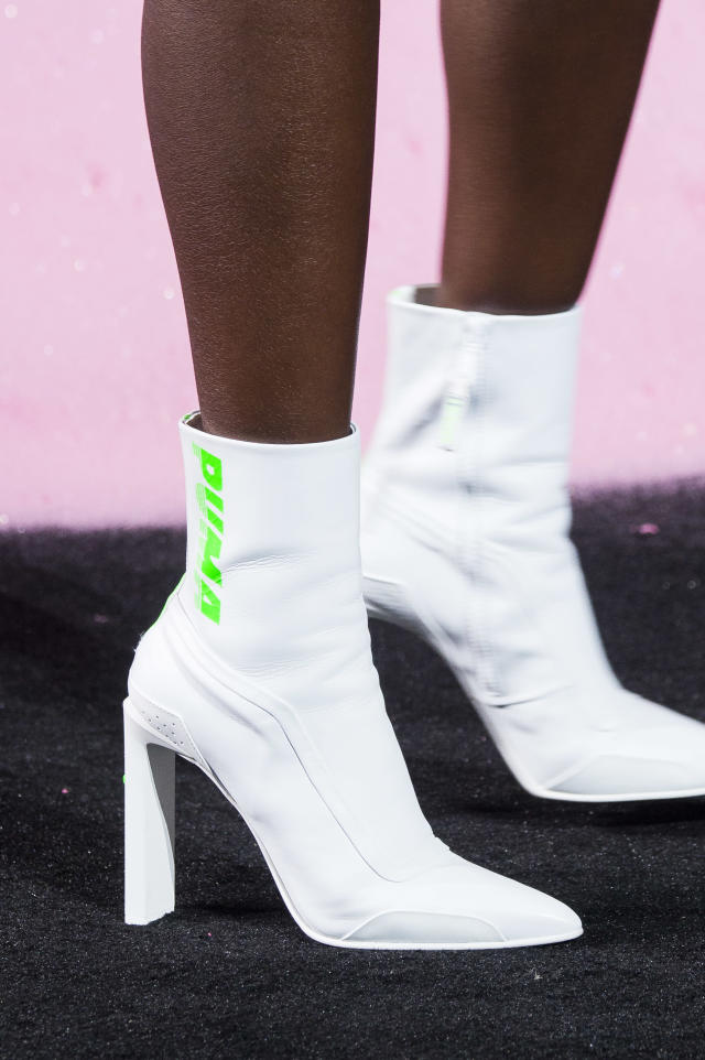 <p><i>White boots with green Puma logo from the SS18 Puma collection. (Photo: ImaxTree) </i></p>