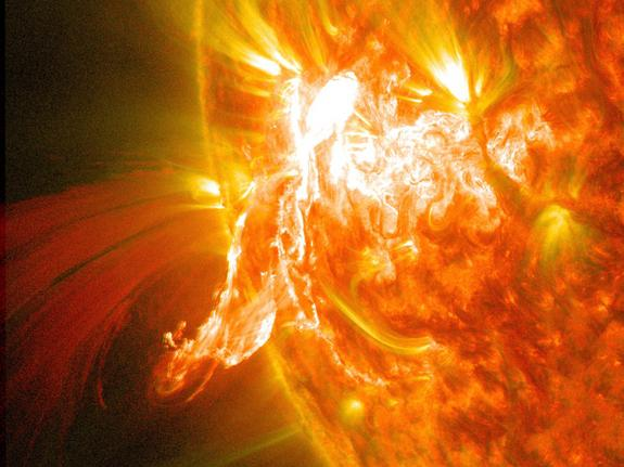 A solar flare erupts on Jan. 30, 2014, as seen by the bright flash on the left side of the sun, captured here by NASA's Solar Dynamics Observatory.