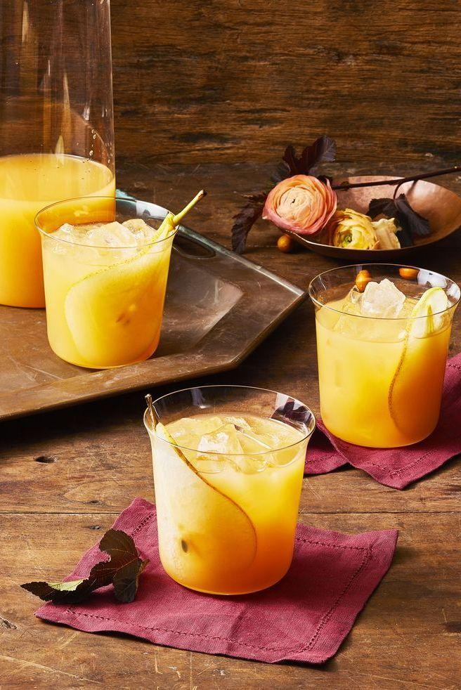 """<p>There are so many yummy fall flavors that taste delicious in cocktails. Mix individual drinks or whip up a large batch of punch in the morning. This one includes pear, ginger beer, lemon, and bitters. </p><p><em><a href=""""https://www.goodhousekeeping.com/food-recipes/party-ideas/a29417605/fall-punch-recipe/"""" rel=""""nofollow noopener"""" target=""""_blank"""" data-ylk=""""slk:Get the recipe for Fall Punch »"""" class=""""link rapid-noclick-resp"""">Get the recipe for Fall Punch »</a></em></p><p><strong>RELATED:</strong> <a href=""""https://www.goodhousekeeping.com/food-recipes/party-ideas/g33457467/fall-cocktails/"""" rel=""""nofollow noopener"""" target=""""_blank"""" data-ylk=""""slk:20 Best Fall Cocktails to Sip This Autumn"""" class=""""link rapid-noclick-resp"""">20 Best Fall Cocktails to Sip This Autumn</a><br></p>"""