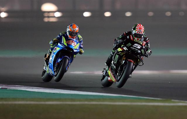 Motorcycle Racing - Qatar Motorcycle Grand Prix - MotoGP Second Qualifying Session - Losail, Qatar, March 17, 2018 - Team Suzuki Ecstar rider Alex Rins of Spain and Monster Yamaha Tech 3 rider Johann Zarco of France compete. REUTERS/Ibraheem Al Omari