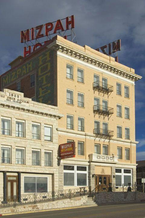 """<p>The 47-room desert oasis features classic furnishings in the guest rooms and slot machines in the lobby. More tempting for some is the """"Lady in Red,"""" who many believe is the ghost of a cheating wife who was caught red-handed by her husband on the fifth floor.<br></p><p><a class=""""link rapid-noclick-resp"""" href=""""https://go.redirectingat.com?id=74968X1596630&url=https%3A%2F%2Fwww.tripadvisor.com%2FHotel_Review-g46006-d2328142-Reviews-Mizpah_Hotel-Tonopah_Nevada.html&sref=https%3A%2F%2Fwww.countryliving.com%2Flife%2Ftravel%2Fg2689%2Fmost-haunted-hotels-in-america%2F"""" rel=""""nofollow noopener"""" target=""""_blank"""" data-ylk=""""slk:PLAN YOUR TRIP"""">PLAN YOUR TRIP</a></p>"""