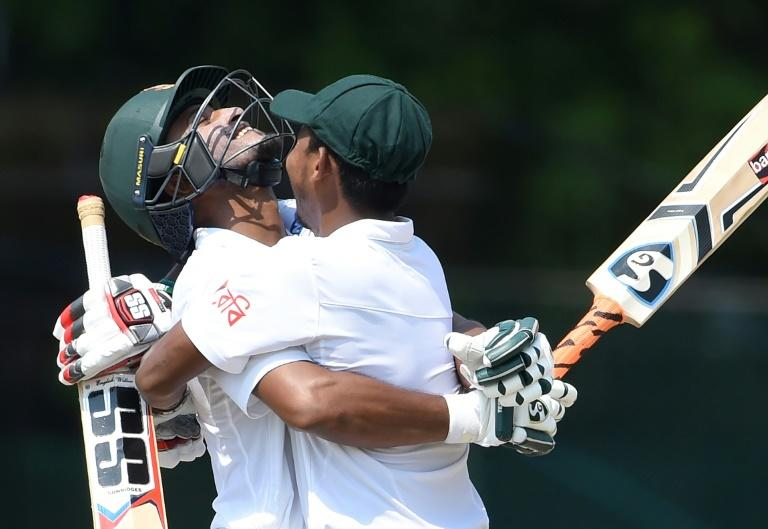 Bangladesh batsman Shakib Al Hasan (left) is embraced by teammate Mosaddek Hossain after reaching his century on the third day of the second Test against Sri Lanka in Colombo on March 17, 2017