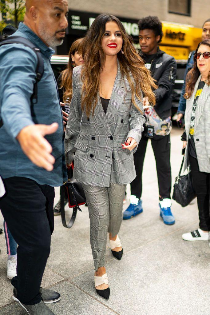<p>The 27 year-old wore a checked, oversized suit, October 2019.</p>