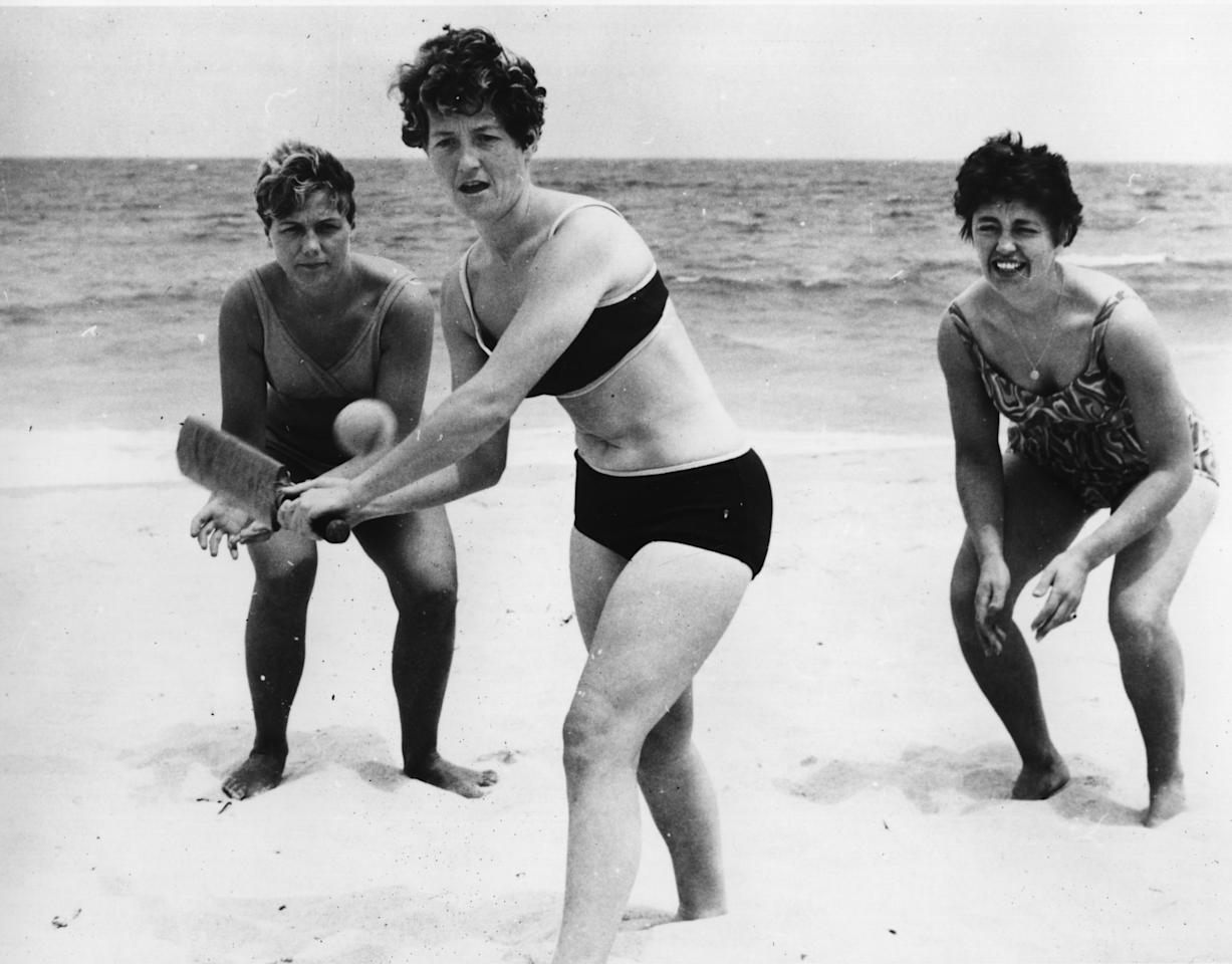 English cricketers Rachel Heyhoe-Flint, (batting), Edna Barker, (wicket keeper), and Audrey Disbury practising on Perth beach during their tour of Australia.    (Photo by Central Press/Getty Images)