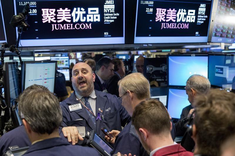 Specialist Peter Giacchi shouts a trading price for Jumei during the company's IPO on the floor of the New York Stock Exchange