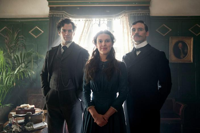 "Teenage Enola Holmes (Millie Bobby Brown) reconnects with her brothers Sherlock (Henry Cavill) and Mycroft (Sam Claflin) in the Netflix action-adventure ""Enola Holmes."""