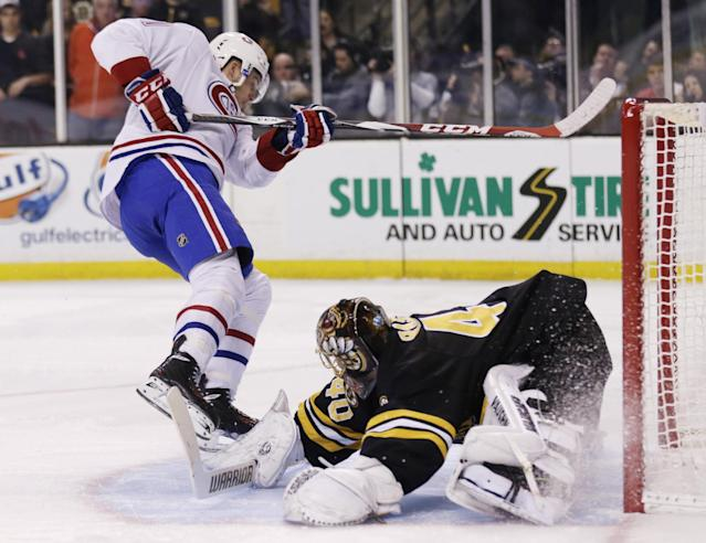Montreal Canadiens center Alex Galchenyuk (27) scores winning goal on Boston Bruins goalie Tuukka Rask (40) in a shootout during an NHL hockey game, Monday, March 24, 2014, in Boston. The Canadiens defeated the Bruins 2-1. (AP Photo/Charles Krupa)