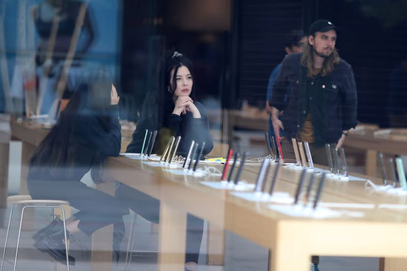 People sit inside a closed Apple Store during the global outbreak of coronavirus (COVID-19) in Santa Monica