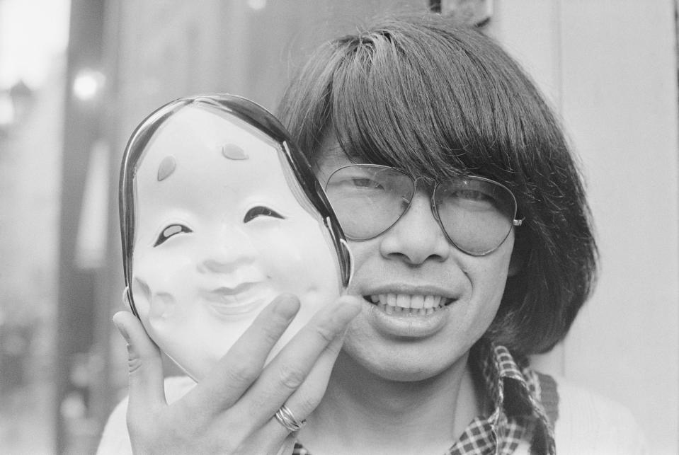 Japanese fashion designer Kenzo Takada holds a theatrical mask. He created the designer fashion label Kenzo and retired in 1999. (Photo by Pierre Vauthey/Sygma/Sygma via Getty Images)