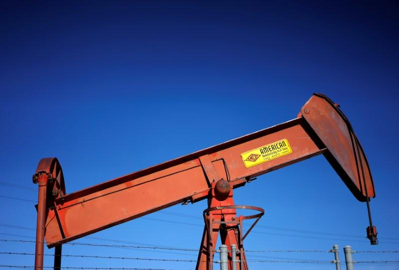 FILE PHOTO: An oil well pump jack is seen at an oil field supply yard near Denver, Colorado, U.S., February 2, 2015. REUTERS/Rick Wilking/File Photo