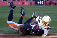 Denver Broncos wide receiver Courtland Sutton scores past Los Angeles Chargers cornerback Casey Hayward during the first half of an NFL football game Sunday, Dec. 1, 2019, in Denver. This was Denver Broncos quarterback Drew Lock's first touchdown pass. (AP Photo/Jack Dempsey)