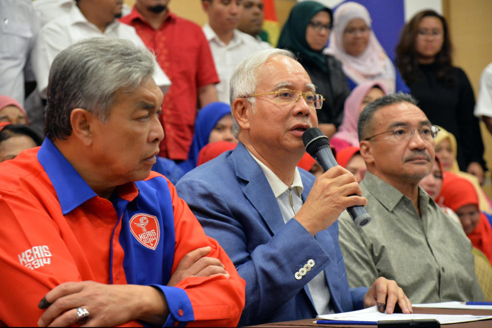 Former Malaysian Prime Minister Najib Razak, center, speaks during a press conference in Kuala Lumpur, Malaysia, on May 12, 2018. Najib was found guilty Tuesday, July 28, 2020 in his first corruption trial linked to one of the world's biggest financial scandals - the billion-dollar looting of the 1MDB state investment fund. (AP Photo)