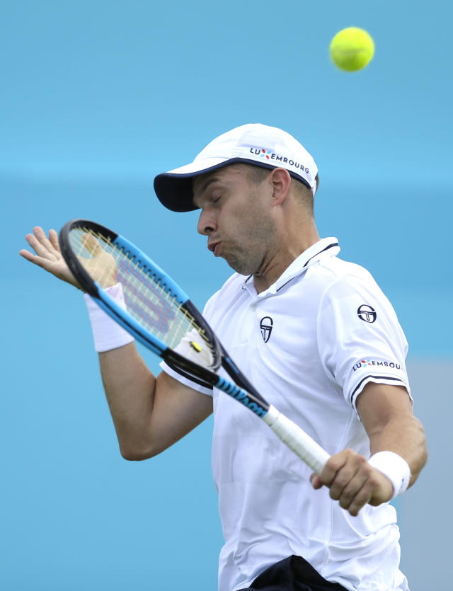 Gilles Muller of Luxembourg plays a return to Marin Cilic of Croatia during their singles tennis match at the Queen's Club tennis tournament in London, Wednesday, June 20, 2018. (AP Photo/Kirsty Wigglesworth)