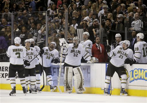 The Dallas Stars players react to their team's 4-3 overtime loss to the Los Angeles Kings after an NHL hockey game in Los Angeles, Sunday, April 21, 2013. (AP Photo/Jae C. Hong)