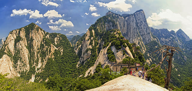 <p>Imagine taking a selfie while trying to navigate a death-defying trail on a tiny wooden ledge which hugs the sides of a 7,087-foot-high cliff, with barely anything more than an iron chain to hold on to in some places. This is Mount Hua located near the city of Huayin, in Shaanxi province – among the world's most dangerous hiking trails in the world. While the authorities have been working on reinforcing security features, according to reports, the trail sees around 100 accidents every year.<br /><br /><em>Image credit: By chensiyuan (chensiyuan) [GFDL (http://www.gnu.org/copyleft/fdl.html) or CC BY-SA 4.0 (https://creativecommons.org/licenses/by-sa/4.0)], via Wikimedia Commons</em> </p>