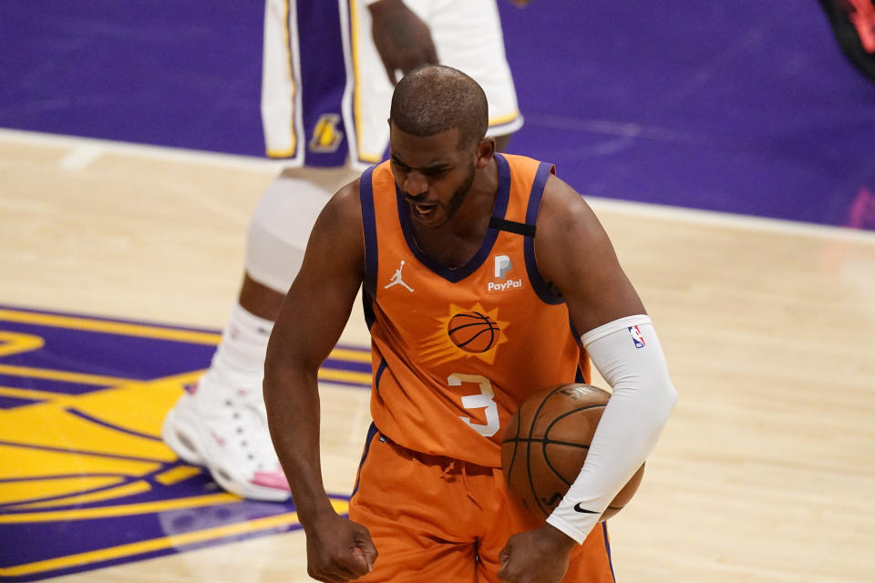 Phoenix Suns guard Chris Paul celebrates after forcing a turnover during the second half in Game 4 of an NBA basketball first-round playoff series against the Los Angeles Lakers Sunday, May 30, 2021, in Los Angeles. (AP Photo/Mark J. Terrill)