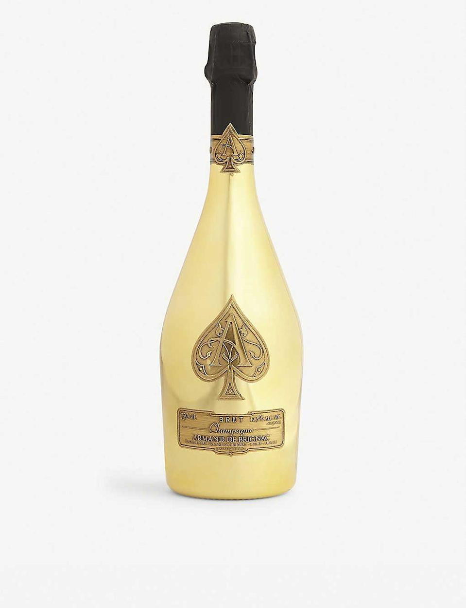 """<p><strong>Armand de Brignac</strong></p><p>Armand de Brignac Brut Gold </p><p><strong>$299.99</strong></p><p><a href=""""https://go.redirectingat.com?id=74968X1596630&url=http%3A%2F%2Fwww.wine.com%2Fv6%2FArmand-de-Brignac-Brut-Gold-Ace-of-Spades-with-Gift-Box%2Fwine%2F91199%2FDetail.aspx&sref=https%3A%2F%2Fwww.harpersbazaar.com%2Fculture%2Ftravel-dining%2Fg33503091%2Fbest-celebrity-owned-wine-brands%2F"""" rel=""""nofollow noopener"""" target=""""_blank"""" data-ylk=""""slk:Shop Now"""" class=""""link rapid-noclick-resp"""">Shop Now</a></p><p>Few things are more luxe than pouring yourself a glass of Jay-Z's Armand de Brignac brut. With hints of peach, apricot, orange blossom, and brioche, it's a perfectly light yet slightly toasty sip perfect for kicking off any celebration. The brut's lavish gold-mirrored bottle also makes the champagne an ideal gift. </p>"""