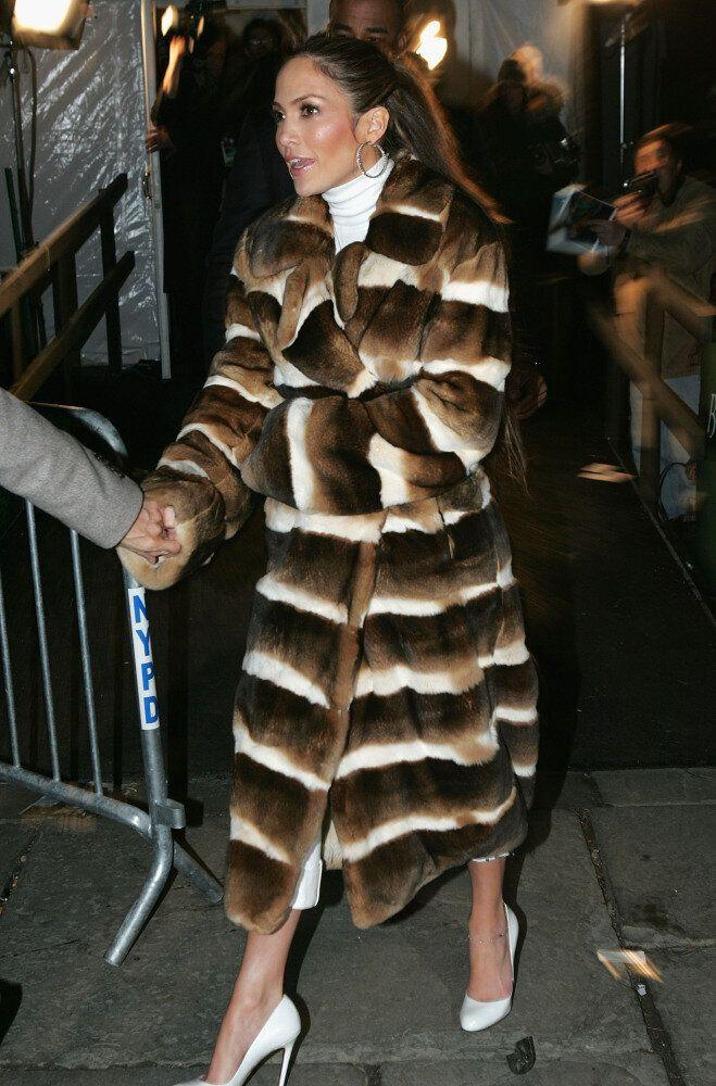 Actress Jennifer Lopez leaves her A/W 2005 show during New York Fashion Week wearing a full-length fur coat.