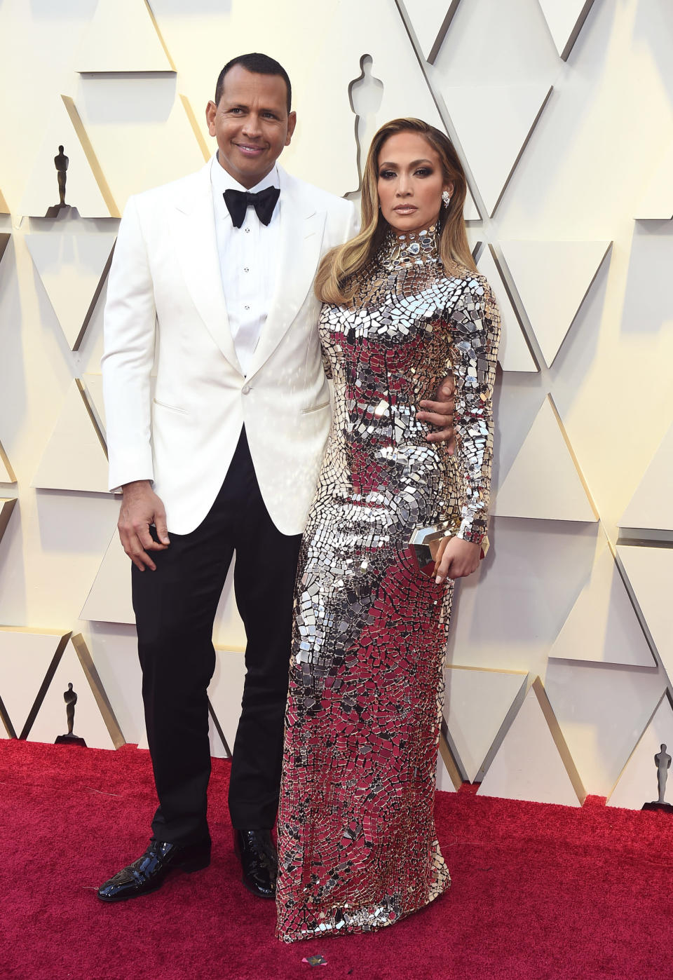 "FILE - Alex Rodriguez, left, and Jennifer Lopez arrive at the Oscars in Los Angeles on Feb. 24, 2019. Lopez and Rodriguez told the ""Today"" show Thursday, April 15,2021, in a joint statement that they are calling off their two-year engagement. (Photo by Jordan Strauss/Invision/AP, File)"