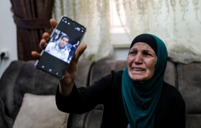 The mother of a Palestinian man with special needs, shot dead by Israeli police when they mistakenly thought was armed with a pistol (AFP Photo/Ahmad GHARABLI)