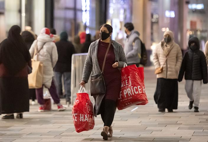 Shoppers in Leicester during the Boxing Day sales. Boxing Day spending is expected to fall by more than a quarter compared with a year ago, after extensive new Covid-19 restrictions forced non-essential retailers to close. (Photo by Joe Giddens/PA Images via Getty Images)
