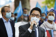 Hong Kong activist Nathan Law speaks as he takes part in a protest during the visit of Chinese Foreign Minister Wang Yi in Berlin, Germany, Tuesday, Sept. 1, 2020. German Foreign Minister Heiko Maas meets his Chinese counterpart at the foreign ministry guest house Villa Borsig for bilateral talks. (AP Photo/Markus Schreiber)