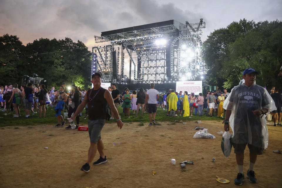 Concertgoers exit The Great Lawn in Central Park after organizers cancel the We Love NYC: The Homecoming Concert due to approaching thunderstorms on Saturday, Aug. 21, 2021, in New York. (Photo by Andy Kropa/Invision/AP)
