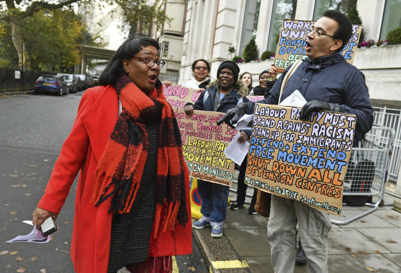 Britain's main opposition Labour Party Shadow home secretary Diane Abbott is greeted by pro-immigration protesters ahead of a meeting to finalise the manifesto details that will form Labour Party policy for the upcoming General Election in London, Saturday Nov. 16, 2019. Britain's Brexit is one of the main issues for voters and political parties as the UK goes to the polls in a General Election on Dec. 12. (Dominc Lipinski/PA via AP)