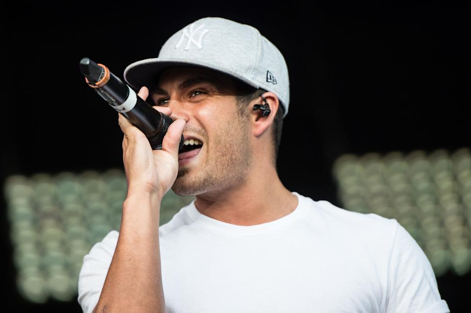 BIRMINGHAM, UNITED KINGDOM - AUGUST 31: Max George of The Wanted performs onstage during day 2 of Fusioni Festival 2014 on August 31, 2014 in Birmingham, England. (Photo by Ollie Millington/Redferns via Getty Images)