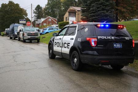 Police vehicles are deployed near the vicinity of the home of Pittsburgh synagogue shooting suspect Robert Bowers' home in Baldwin borough suburb of Pittsburgh