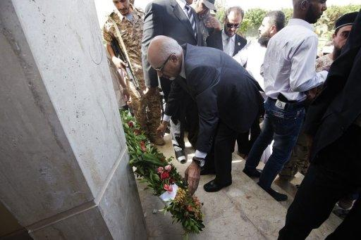 Mohammed al-Megaryef (C), president of Libya's  General National Congress, lays a wreath in Benghazi