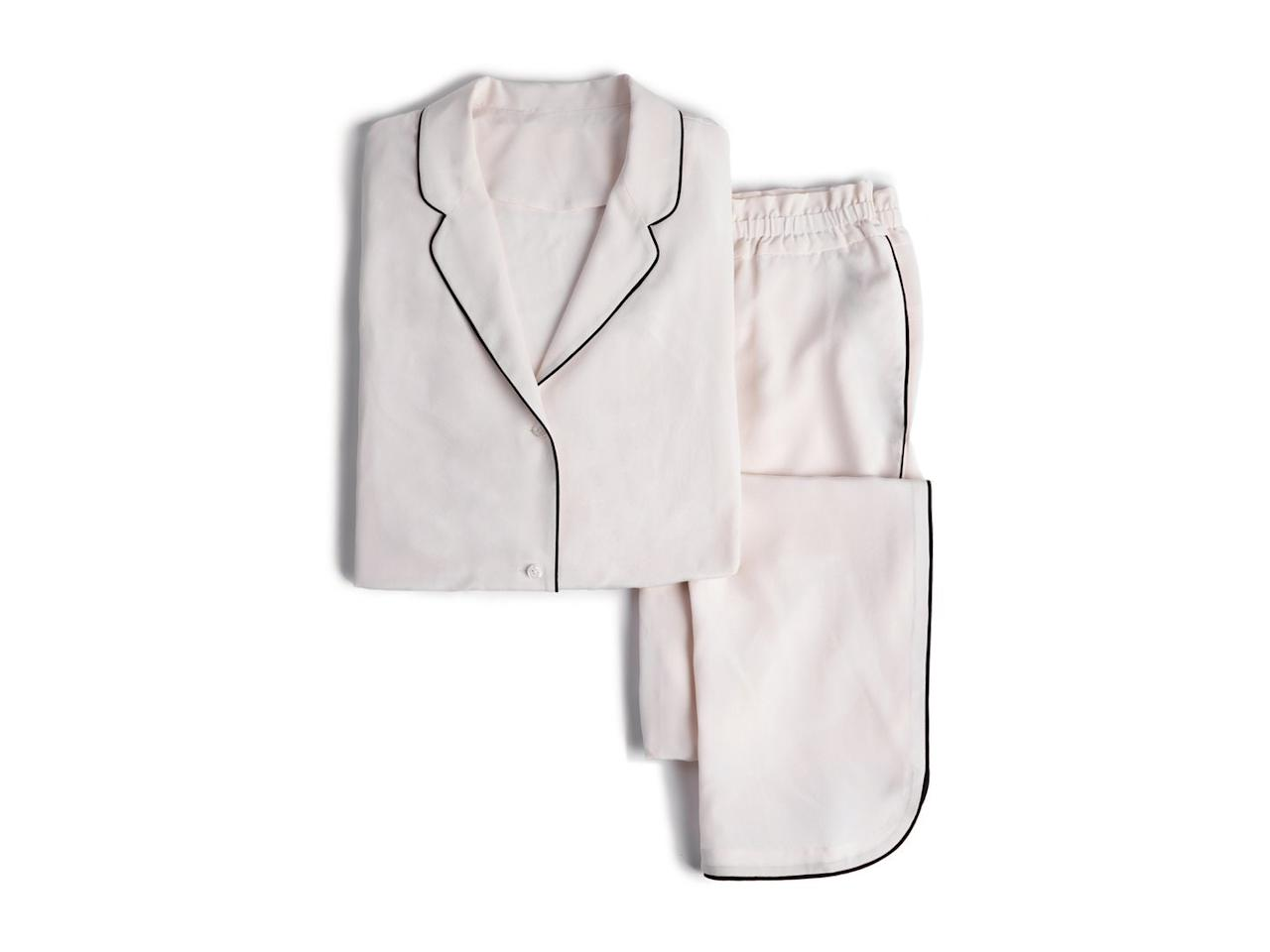 """<p>With the scrunched elastic waistband and black piping down the leg, this crepe de Chine silk set from Parachute could easily be mistaken for luxe athleisure pieces. (We won't tell if you won't.)</p> <p><strong>$299</strong> (<a href=""""https://www.parachutehome.com/products/silk-pajama-sets?opt-color=blush"""" rel=""""nofollow"""">Shop Now</a>)</p>"""