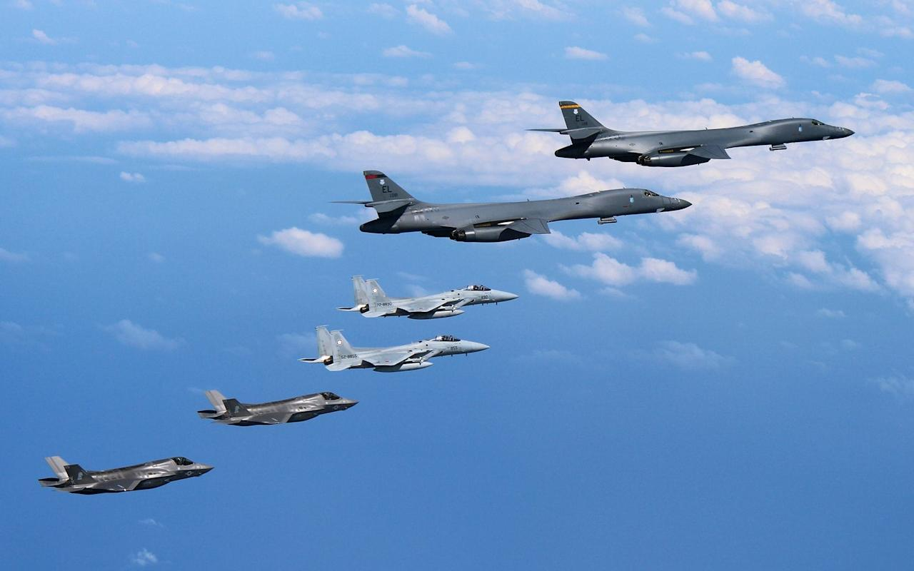 "US bombers flew over waters east of North Korea on Saturday in a show of force, flying further north over the border with South Korea than ever before this century. The B-1B Lancer bombers were escorted by fighter jets as they flew in international airspace. ""This is the farthest north of the Demilitarized Zone (DMZ) any US fighter or bomber aircraft have flown off North Korea's coast in the 21st century, underscoring the seriousness with which we take (North Korea's) reckless behavior,"" said Dana White, spokesman for the Pentagon. The Pentagon said the flight was in response to the ""grave threat"" that North Korea posed to the Asia-Pacific region, and the international community.  The flights are a ""demonstration of US resolve and a clear message"" that President Donald Trump ""has many military options to defeat any threat,"" she said. Ms White added: ""we are prepared to use the full range of military capabilities to defend the U.S. homeland and our allies."" Participants of a mass rally shout slogans as they gather before a banner reading 'let us beat down the sanctions of the imperialists with great progress of self-reliance' on Kim Il-Sung sqaure in Pyongyang on September 23, 2017 Credit: AFP The flights come at the end of a heated week of rhetoric, with Mr Trump threatening to ""totally destroy"" the country, and Kim Jong-un responding, in a rare first-person letter in the state press, that Mr Trump was a ""dotard"". Some analysts have expressed concern at what they see as the goading of Mr Kim. Joe Cirincione, president of the Ploughshares Fund, which supports nuclear weapon reduction and eventual elimination, said the US risks a ""stumble into war."" Trump: We'll deal with 'Little Rocket Man' Kim Jong-u 01:34 He told The Hill:  ""We have the pressure. It's time for the engagement. You have got to walk back from the brink here."" Michael Fuchs, who worked at the state department under Barack Obama said that ""by any measure President Trump's quote-unquote 'strategy' is not working."" ""This is squarely in the hands of the president himself,"" he said. ""The rest of his administration, so far at least, seems willing to carry out a strategy focused on deterrence, reassurance, pressure and diplomacy. Members of the People's Security Council take part an anti-U.S. rally, in this September 23, 2017 photo released by North Korea's Korean Central News Agency (KCNA) in Pyongyang. Credit: REUTERS ""But the president from time to time lobs a grenade on top of these efforts, and spins the escalation up again."" But Mr Trump's supporters praised his bold stance. Duncan Hunter, a Republican  congressman for California, worried that the North Koreans might soon be able to strike the west coast of the United States with a nuclear weapon.  ""The question is, do you wait for one of those? Or two? Do you preemptively strike them? And that's what the president has to wrestle with,"" he said. Kim Jong Un's message for Trump 01:28 ""I would preemptively strike them. You could call it declaring war, call it whatever you want."" John Bolton, who was George W. Bush's ambassador to the United Nations, said he thought a pre-emptive strike could soon be considered.  ""We're getting very close to that point,"" he said."